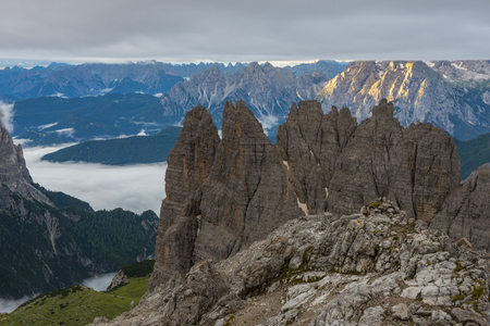 Italy, Alto Adige, Dolomites, view to Cadini di Misurina mountains at sunrise on a cloudy day