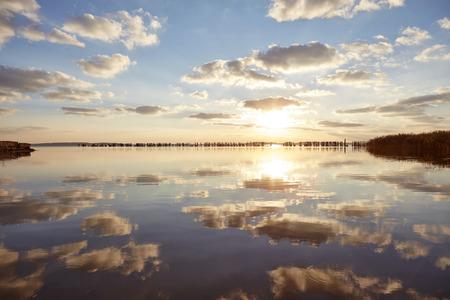 lighted: Germany, Mecklenburg-Western Pomerania, Ruegen Island, Glowe, Spyckerscher See at sunset
