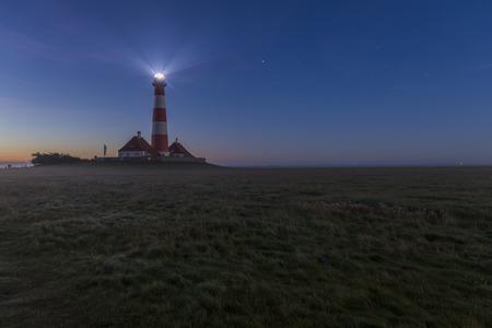westerheversand: Germany, Schleswig-Holstein, North Sea Coast, View of Westerheversand Lighthouse at night LANG_EVOIMAGES