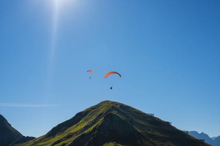 lighted: Germany, Bavaria, Allgaeu, paragliders at Nebelhorn LANG_EVOIMAGES