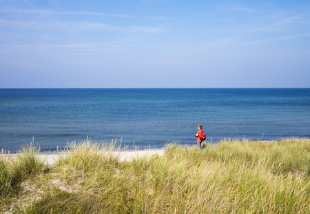 Germany, Mecklenburg-Western Pomerania, woman at Baltic Sea coast in Born auf dem Darss LANG_EVOIMAGES