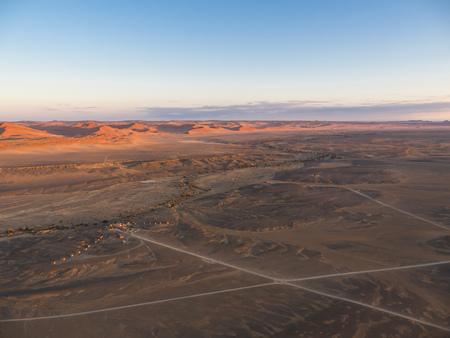 Africa, Namibia, Hardap, Hammerstein, Kulala Wilderness Reserve, Tsaris Mountains, Sossusvlei Region, Namib desert, Kuala Desert Lodge sunset