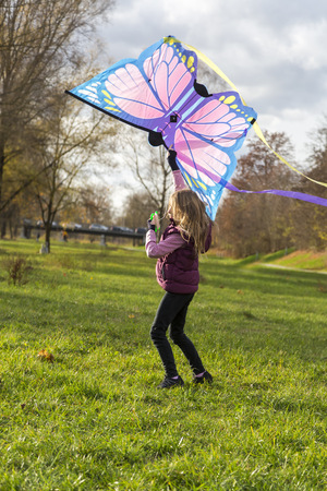 Young girl with kite