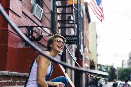 in low spirits: USA, New York City, Williamsburg, portrait of happy blond woman