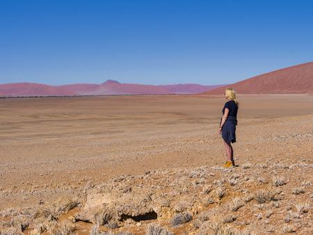 Africa, Namibia, Hardap, Hammerstein, Tsaris Mountains, female tourist standing in the namib desert