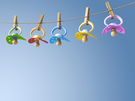 Five pacifiers hanging on a washing line, 3D Rendering