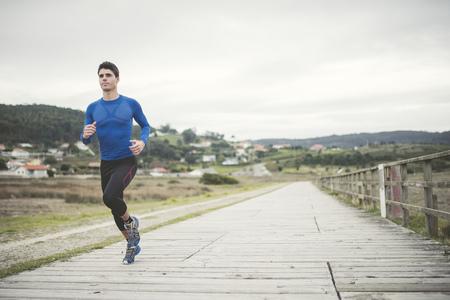secluded: Spain, Ferrol, jogger running on a boardwalk