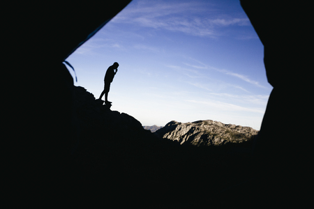 mountaintops: Spain, Picos de Europa, silhouette of a man with mountains landscape