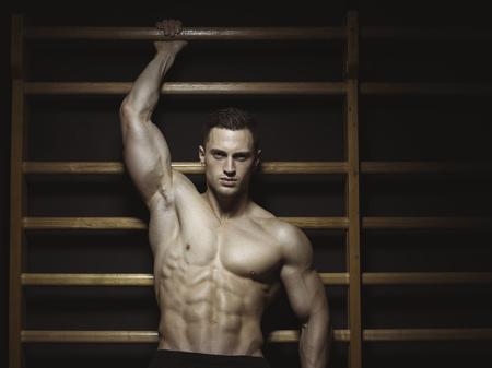 motivations: Athlete on wall bars