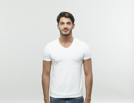 Portrait of bearded young blond man wearing white t-shirt LANG_EVOIMAGES