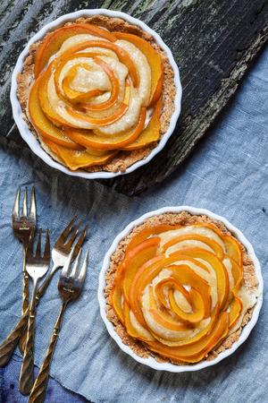 Two almond pies with kaki slices