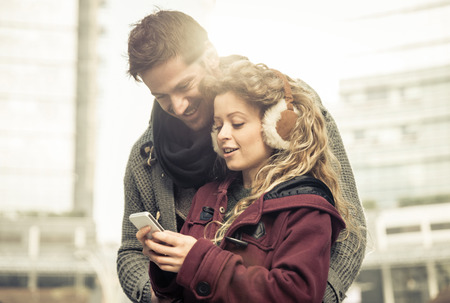 Couple looking together at smartphone