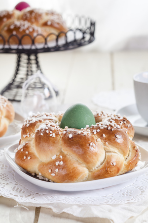 Braided Easter bread with green egg LANG_EVOIMAGES