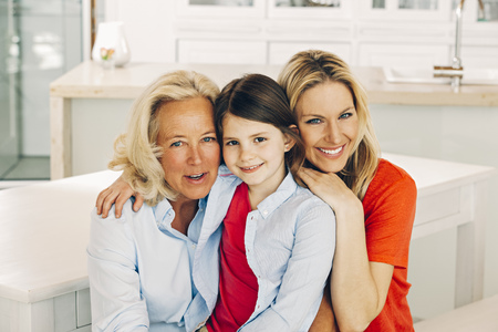 three generations: Portrait of smiling grandmother, mother and daughter