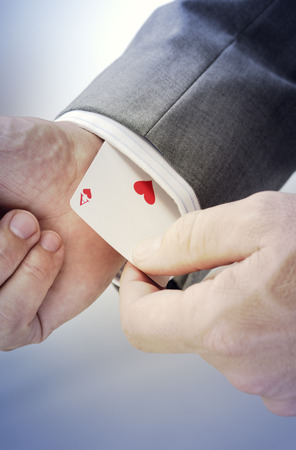 Business man, playing card with heart and ace LANG_EVOIMAGES