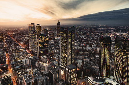 Germany, Frankfurt, elevated view to the lighted city at evening twilight