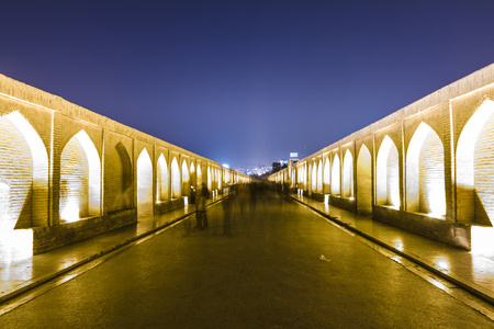 lighted: Iran, Isfahan, lighted arch bridge Siosepol in the evening