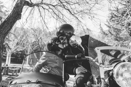 combination: Mature couple kissing on sidecar motorbike