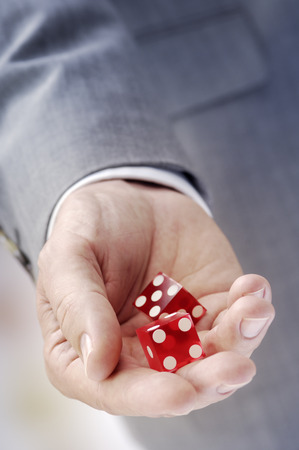 Hand with red dices LANG_EVOIMAGES