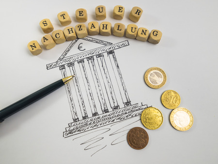 Drawing of a tax office, ballpen, alphabet cubes and coins LANG_EVOIMAGES