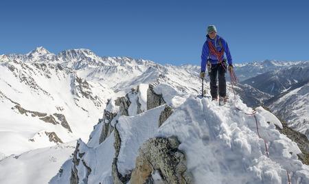 Italy, Grand St Bernard Pass, Mont Fourchon, smiling man on summit
