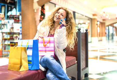 Italy, Lombardy, Milan, Woman with shopping bags in a shopping center