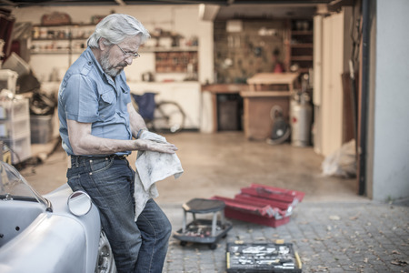 cruddy: Senior man restoring a car