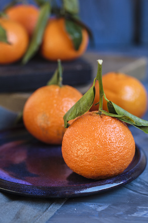 Clementines on plate