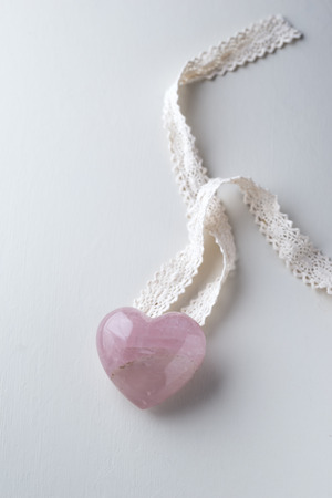 Heart shaped rose quartz and lace