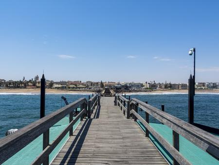 Namibia, Swakopmund, wooden pier and beach