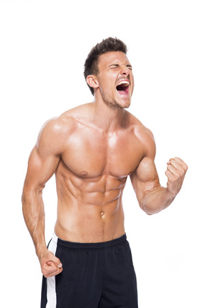 Screaming shirtless muscular man in front of white background