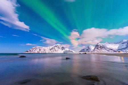 Norway, Lofoten, Aurora over Skagsanden beach