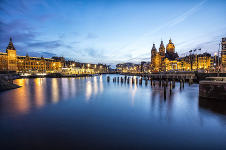 Netherlands, Holland, Amsterdam, Central Station in the evening