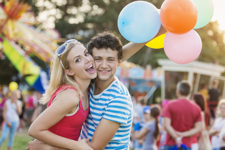 decorating: Happy couple at fun fair