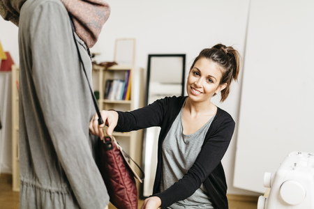 decorating: Young fashion designer working in her studio