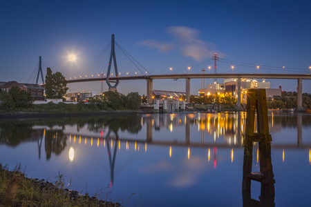 Germany, Hamburg, Koehlbrand Bridge and full moon at night