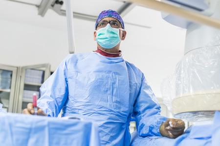 Intervetional radiologist at surgery