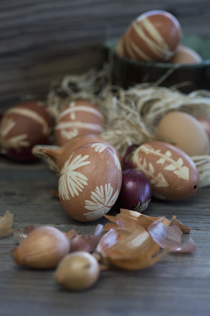 close up of onions in a basket: Easter eggs dyed with onion skins