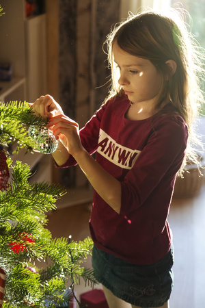 decorating: Girl decorating Christmas tree