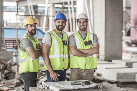 Portrait of confident construction workers in construction site
