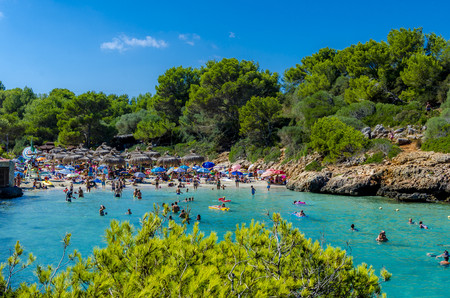 Spain, Mallorca, Cala Sa Nau, beach and tourists LANG_EVOIMAGES
