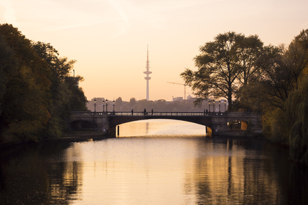 Germany, Hamburg, Heinrich-Hertz Tower at sunset, Outer Alster Lake LANG_EVOIMAGES