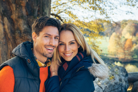 Portrait of happy couple in autumn forest