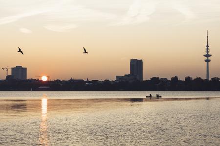 Germany, Hamburg, Outer Alster Lake at sunset, Heinrich-Hertz Tower right LANG_EVOIMAGES