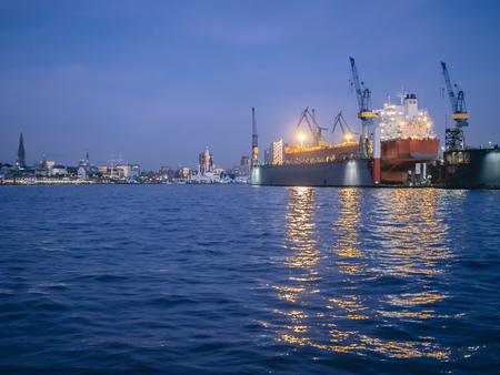 shipbuilding: Germany, Hamburg, Harbour, Containership in a dock in the evening