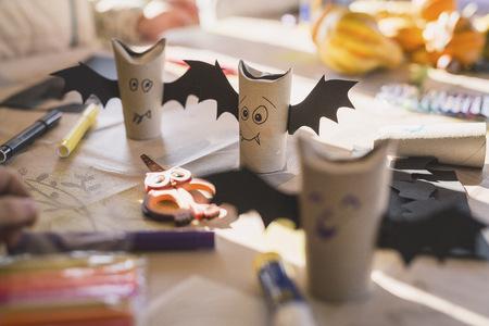 tinkered: Tinkered paper bats on desk