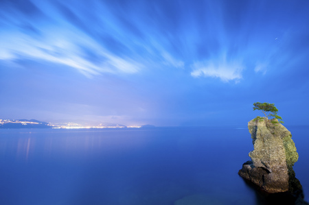 Italy, rock formation, blue hour, cloudy sky LANG_EVOIMAGES