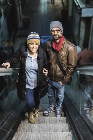 Portrait of couple on escalator LANG_EVOIMAGES