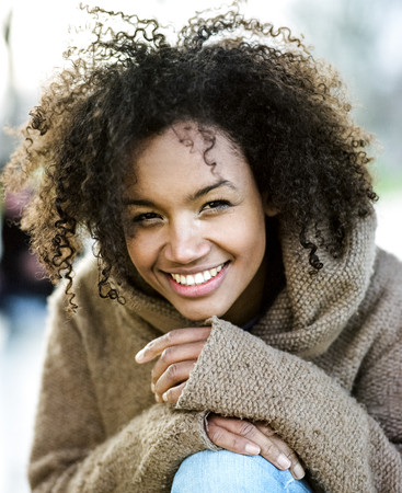 Portrait of smiling young woman with afro