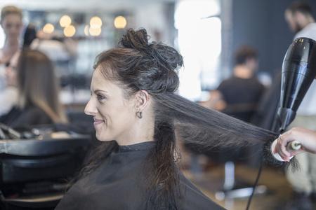 dryer: Woman in hair salon getting hair dried